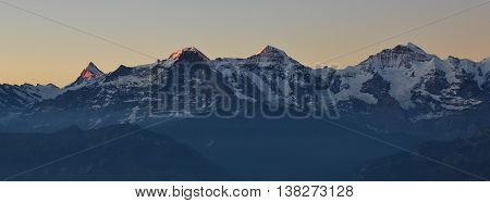Famous mountains Eiger Monch and Jungfrau. Morning scene in Switzerland.