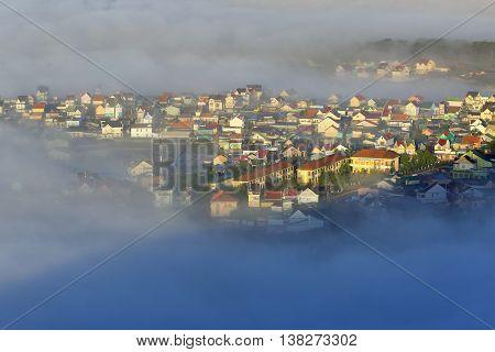 Part of Dalat city in Central highland of Vietnam on morning mist