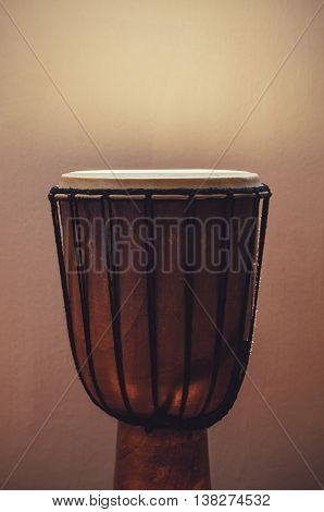 Old wooden brown djembe percussion instrument of Africa Balkan and East.
