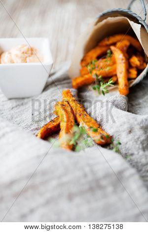 Fresh homemade sweet potato fries with thyme