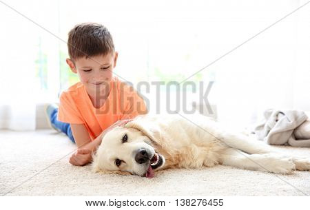 Small boy and cute dog at home
