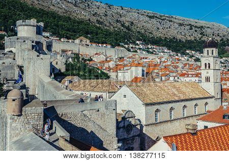 Dubrovnik Croatia - August 26 2015. Tourists walks on the Walls of Dubrovnik. View with Minceta Tower