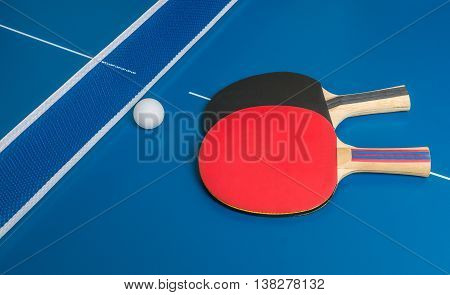 Ping Pong Challenge. Table Tennis Rackets On Blue Table.