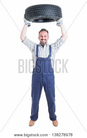 Strong Cheerful Engineer Holding Tire Above Head