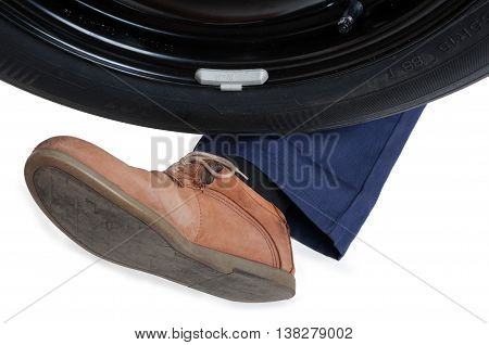 Close-up Of Car Tire And Leg Of Mechanic
