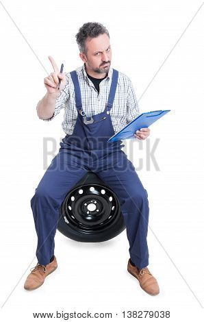 Young Serious Worker With Checklist Making Refusal Gesture