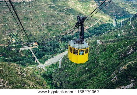 Montserrat Spain - May 25 2015. Man in cable car to Santa Maria de Montserrat Abbey in Montserrat mountains