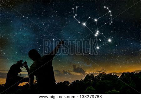 Orion constellation. People are observing night sky.