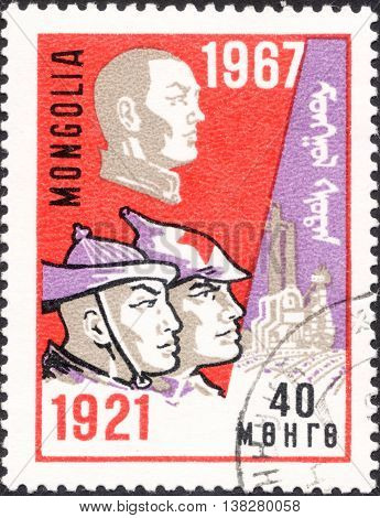 MOSCOW RUSSIA - JANUARY 2016: a post stamp printed in MONGOLIA shows soldiers of the national army the series