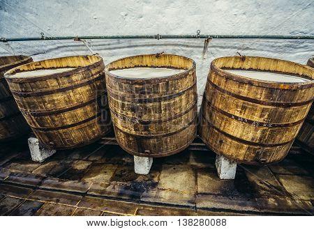 Pilsen Czech Republic - October 3 2015. Old wooden barrels in cellars of Pilsner Urquell Brewery