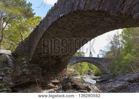 Invermoriston bridges Scotland UK Scottish tourist destination.  The old bridge built by Thomas Telford in 1813 and both cross the spectacular River Moriston falls