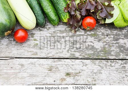 fresh organic vegetables on old rustic table. diet concept. place for your text.