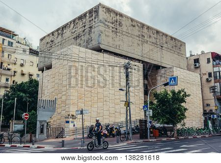 Tel Aviv Israel - October 19 2015. Man rides eletric scooter in front of building of Ichud Shivat Zion Synagogue in Tel Aviv