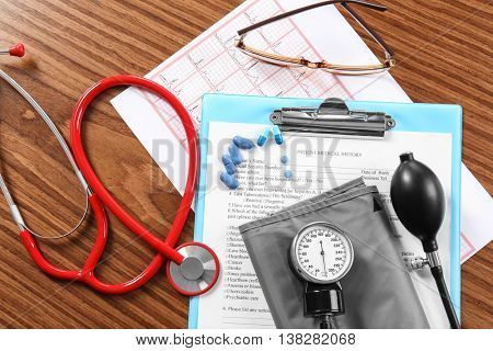 Medical concept. Medical stethoscope and manometer on wooden background