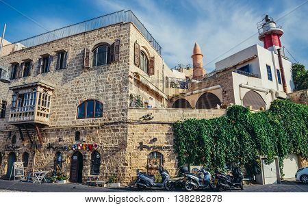 Tel Aviv Israel - October 20 2015. Houses and lighthouse (right) in Jaffa also called Japho or Joppa former port city now part of Tel Aviv