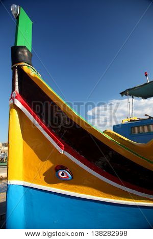 The bows of a traditional Maltese Fishing vessel painted in bright primary colours