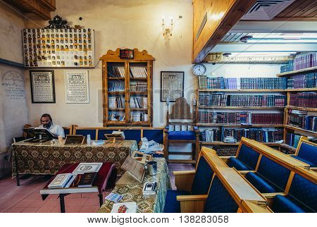 Tel Aviv Israel - October 20 2015. Jew reads holy book in synagogue in historic Neve Tzedek district (lit. Abode of Justice) of Tel Aviv