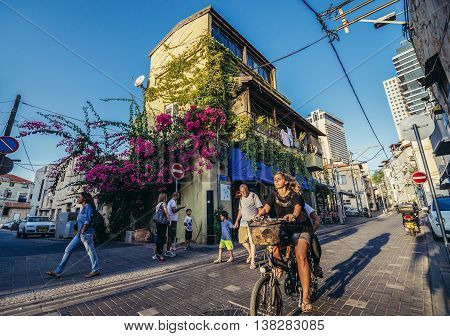 Tel Aviv Israel - October 20 2015. People at the Shalom Shabazi street in historic Neve Tzedek district (lit. Abode of Justice) of Tel Aviv