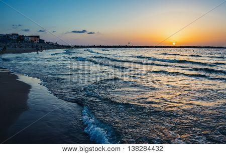 Tel Aviv Israel - October 21 2015. The sun sets over the Mediterranean Sea