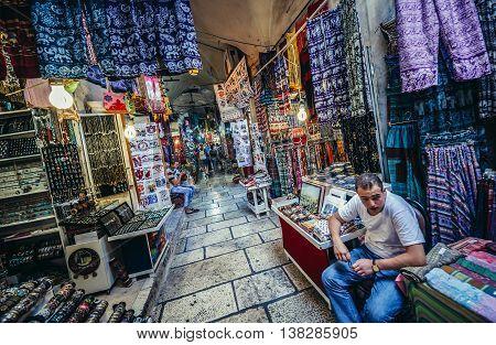 Jerusalem Israel - October 22 2015. Man sells clothes on Arab baazar inside the walls of the Old City of Jerusalem