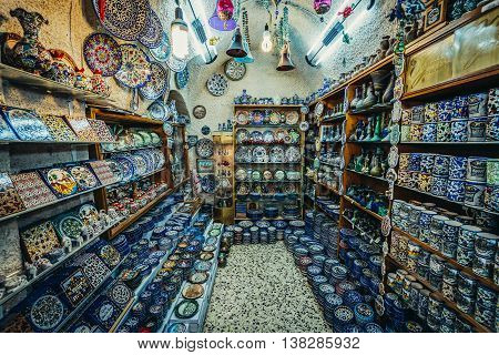 Jerusalem Israel - October 22 2015. Ceramic plates and other souvenirs for sale on Arab baazar located inside the walls of the Old City of Jerusalem