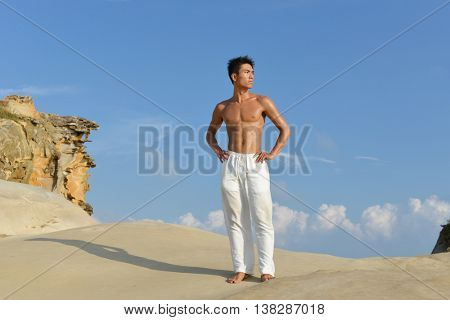 Healthy lifestyle concept - Muscular young man