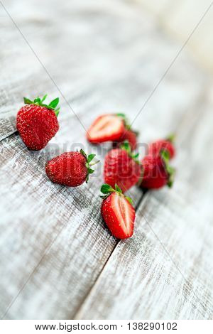 strawberry isolated on a wood background