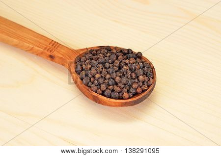 Black Pepper Granules In Wooden Spoon