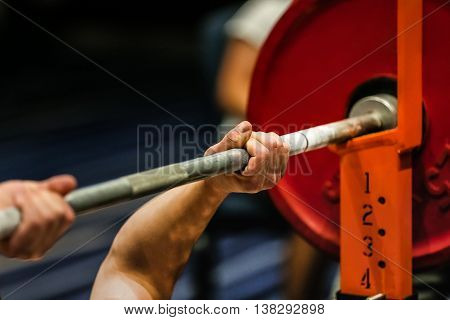athlete powerlifter exercise bench press in powerlifting competitions