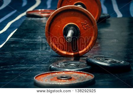barbell and discs in gym for powerlifting