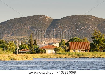 Traditional colorful old houses at the wetland of Oropos in Greece.