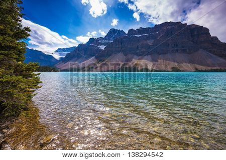 Canadian Rockies, National park Banff. The amazing mountain glacial Bow Lake with water of emerald color