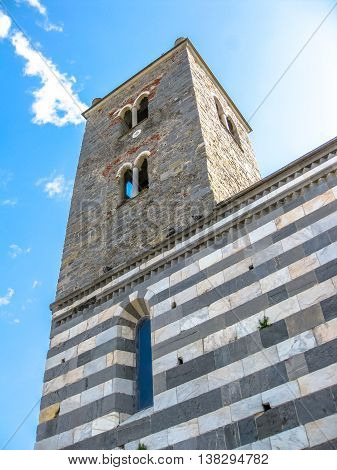 Tower of gothic Church of St. Peter, Chiesa di San Pietro in Porto Venere, Ligurian Coast, La Spezia, Italy.