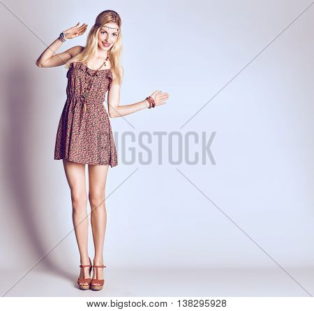 Hippie Boho woman Having Fun. Playful positive Model smiling, Summer Fashion Outfit. Happy Blonde in Trendy Sundress, long hair, ethnic Fashion Accessories. Boho romantic Style. Unusual creative look