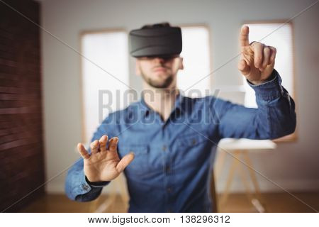 Businessman wearing virtual glass at office