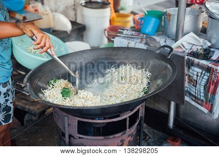 Woman Cooks Stir-fried Noodles With Bean Sprouts