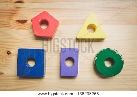 wooden multi coloured children's building blocks flat lay