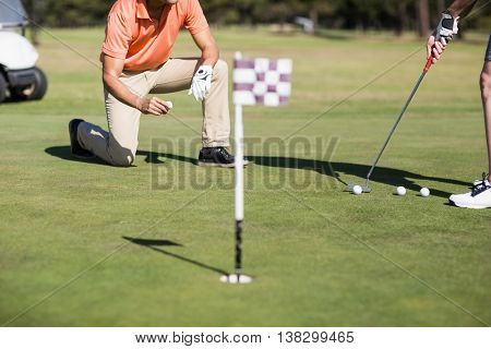 Cropped image of woman playing golf on field