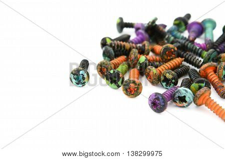 Abstract Of Crosshead Screws, Covered In Paint Splatters