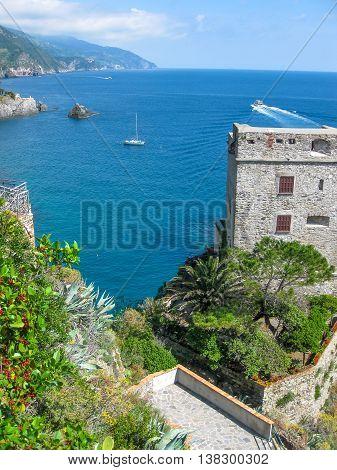 Aerial view of Fieschi Castle in Monterosso al Mare, Cinque Terre. Mediterranean sea in La Spezia, Italy.