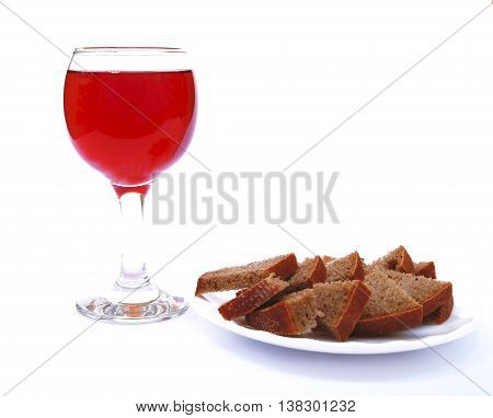 red sparkling wine and bread as symbols of Christianity photo