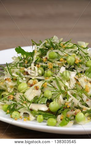 Coleslaw with cucumbers and peas seasoned with dijon mustard and dill