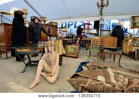 KAUNAS, LITHUANIA - MAR 23: Unidentified people in a traditional flea market in second biggest Lithuanian city - Kaunas, on March 23, 2013 in Kaunas, Lithuania