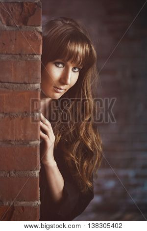 Girl recline on the brick wall