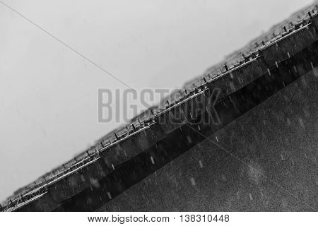 Falling rain drops on a house roof.