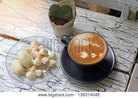 Coffee Cup Of Cappuccino And Thai Cookie With Reflection From Windows.