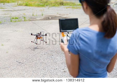 Woman flying the drone