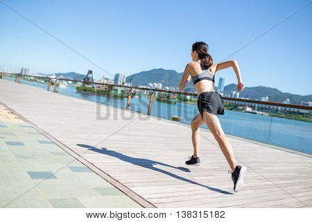Woman run in boardwalk