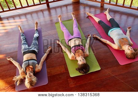 Yoga Class Relaxing In The Corpse Pose, Savasana