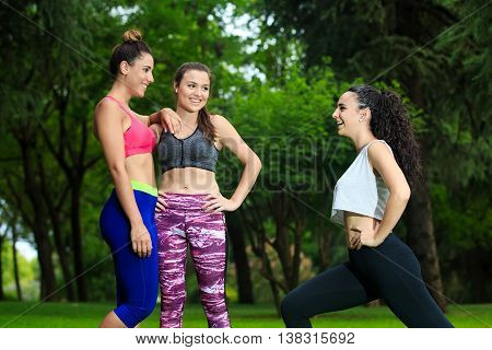 Cheerful Girlfriends Exercising In Park